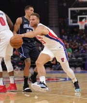 Detroit Pistons forward Blake Griffin dribbles against Orlando Magic forward Aaron Gordon during the first quarter of a preseason game Monday, Oct. 7, 2019 at Little Caesars Arena.