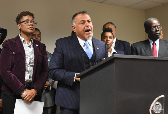 Nabih H. Ayad, attorney for Rhonda Powell, beside him, discusses her whistleblower complaint and her firing from Macomb County during a press conference in Detroit, Tuesday.