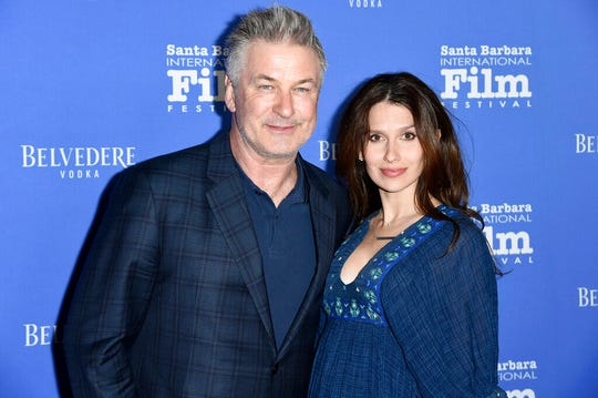 This Jan. 31, 2018 file photo shows Alec Baldwin, left, and Hilaria Baldwin at the Santa Barbara International Film Festival. Baldwin says he fell for a scam Statue of Liberty tour where he says he bought $40 tickets for a boat tour of the Statue of Liberty for his family but was instead escorted to a shuttle bus to New Jersey.