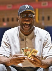 Former Michigan and NFL player Reggie McKenzie with some of his bubble gum cards from his NFL days. Photos taken at the Ernest T. Ford Fieldhouse in Highland Park, Mich. on Sept. 10, 2019.