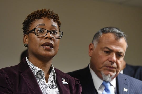 Rhonda Powell, with her attorney Nabih H. Ayad, discusses her whistleblower complaint and her firing from Macomb County during a press conference in Detroit,  Tuesday.