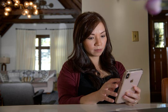 Emergency room physician Dr. Anna Nguyen uses her smartphone to communicate with a remote patient from her Sacramento, Calif., home.