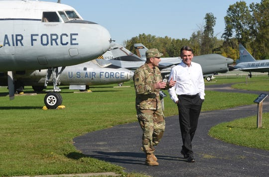 Brigadier General Bryan Teff, commander of Selfridge Air National Guard Base and the 110th Wing, speaks with Macomb County Executive Mark Hackel at the Selfridge Air Museum in Harrison Township last year.