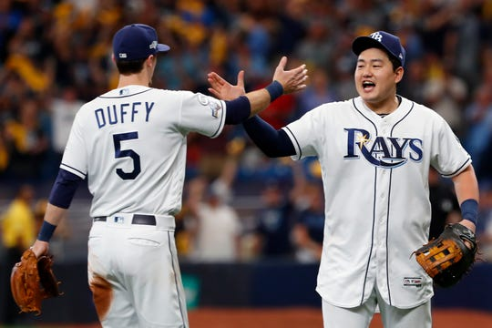 Tampa Bay Rays third baseman Matt Duffy (5) and first baseman Ji-Man Choi, right, celebrate after defeating the Houston Astros in Game 3 of the American League Division Series  Monday.