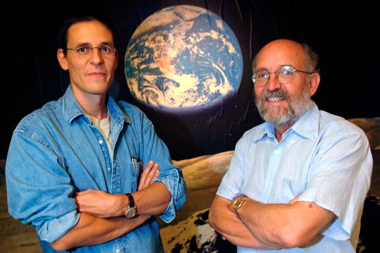 "Swiss Astronomers Michel Mayor, right, and Didier Queloz pose in 2005. They were awarded ""for the discovery of an exoplanet orbiting a solar-type star,"" said Professor Goran Hansson, secretary-general of the Royal Swedish Academy of Sciences that chooses the laureates."
