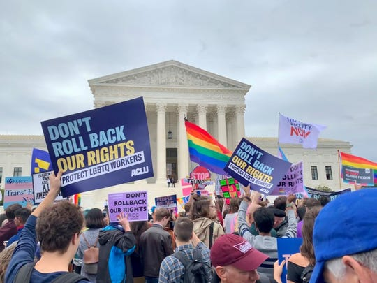 Advocates of gay and transgender rights rallied Tuesday, Oct. 8, 2019, morning outside the U.S. Supreme Court ahead of oral arguments in three high-profile cases.