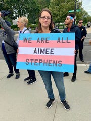 Katherine Fuchs of Washington, D.C., shows support outside the Supreme Court for Michigan's Aimee Stephens, a transgender woman whose workplace bias suit the justices are hearing Tuesday, Oct. 8, 2019.