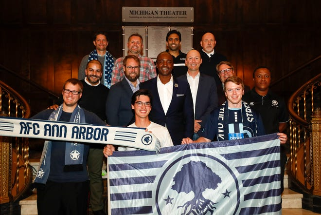 AFC Ann Arbor owners and staff celebrate the announcement of the club's move to USL League 2 Monday at the Michigan Theater in Ann Arbor.