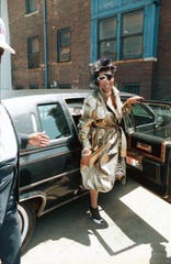 """Aretha Franklin steps out of a limo to film the video for """"Jumpin' Jack Flash"""" in 1986."""