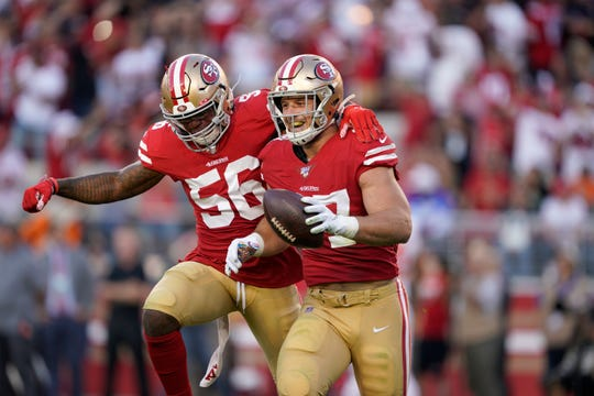 San Francisco 49ers defensive end Nick Bosa, right, celebrates with middle linebacker Kwon Alexander (56) after recovering a fumble by Cleveland Browns quarterback Baker Mayfield during the first half.