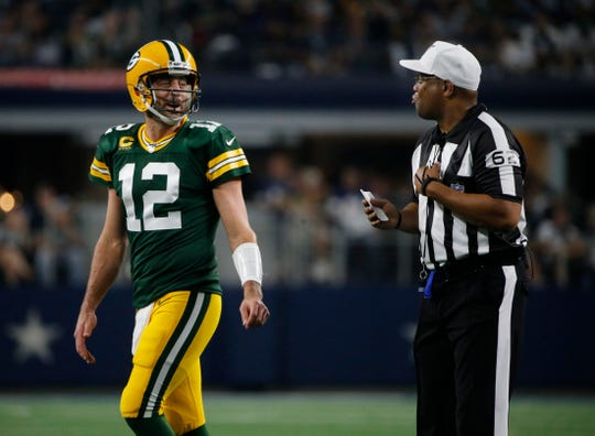 Green Bay Packers quarterback Aaron Rodgers talks to referee Ron Torbert during Sunday's game.