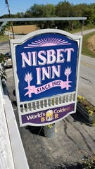 A view of the Nisbet Inn sign from the second floor, where tenants regularly hear ghostly reveling in the wee hours of the morning.