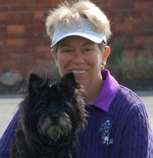 """Suzanne Noblett, with her golf therapy dog, """"Chunk,"""" will be inducted into the Indiana golf HOF Friday."""