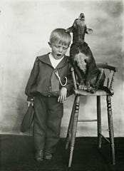 A boy singing with his dog.