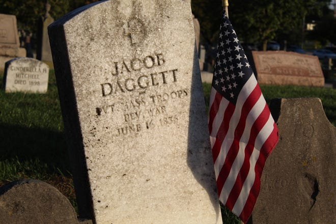 Visitors on the McPherson Cemetery tour in Clyde Tuesday passed by the gravesite of American Revolutionary War veteran Jacob Daggett. The tour is held annually at the cemetery.