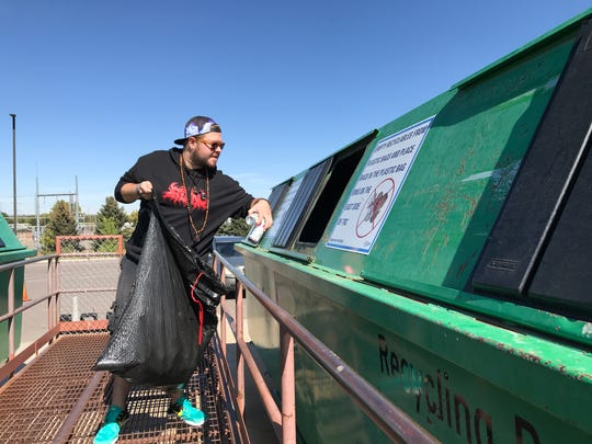 Nathan McGinley of Fort Collins drops off cans at the Timberline Recycling Center on Oct. 7, 2019.