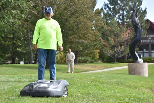 Dale Schwery of Aspen Landscape Management in Berthoud watches his automower cut grass at Hahn Sculpture Park in Loveland on Thursday, Oct. 3, 2019.