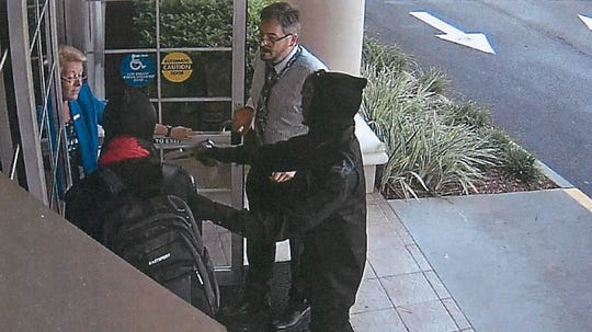 John Armstrong Jr., 30, allegedly the suspect with the gun, has been charged by a federal criminal complaint with Hobbs Act robbery and attempted bank robbery.  The above surveillance camera photo was taken during a robbery at the PNC Bank in Davenport, Florida. Armstrong was reportedly in possession of a silver handgun and working with an accomplice wearing a red bandanna.