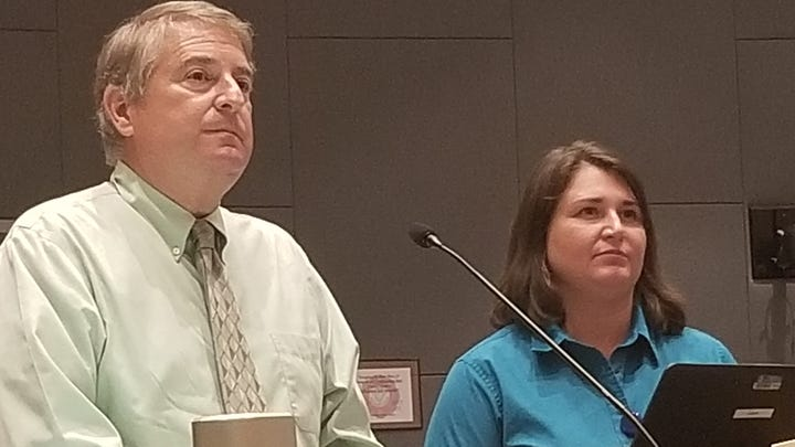 Florida Gulf Coast University geology professor Michael Savarese and Cape Coral Environmental Resources Manager Maya Robert brief the city council on a climate control cooperative involving 14 local agencies