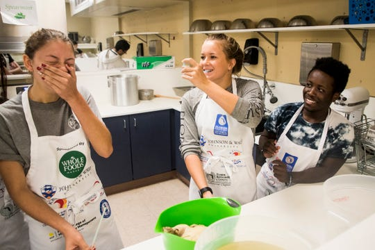 Estero High School culinary student Faith Brownlee, left, takes part in making chicken broth with classmate Kelsey Swartout, right, on Tuesday, Oct. 8, 2019. Faith is one of the team members from Estero High School taking part in a taco-making contest against other schools at the Burroughs Home in Fort Myers next week.
