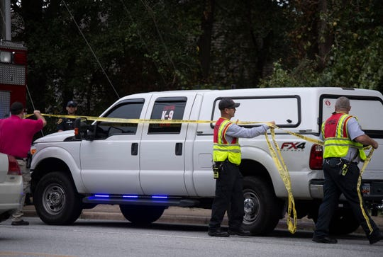 Emergency personnel work on the side of Old Spartanburg Road Tuesday, Oct. 8, 2019.