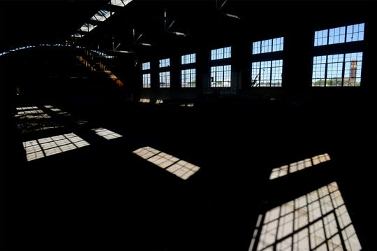 TRIBUNE PHOTO/RION SANDERS The interior of the Holman building on the corner of Central Avenue West and Bay Drive with the Milwaukee depot tower in the background, in 2016.