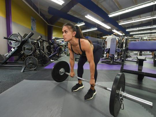 Jeralyn Mesa works on deadlifts at Paradise Fitness Center in Hagåtña, Oct. 8, 2019.