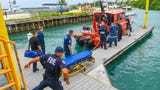 A Guam Fire Department rescue boat docks at the Gregorio D. Perez Marina in Hagåtña with a 15-year-old boy who was rescued after falling approximately 100 feet down from a lookout along the Johnstown cliffline in Tamuning and into the ocean below on Oct. 8, 2019.