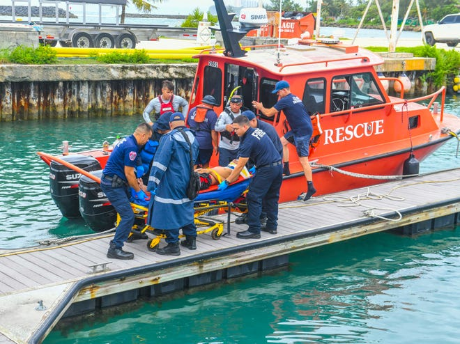 A 15-year-old boy Guam is secured to a gurney by Fire Department personnel in preparation to be transported to the Guam Memorial Hospital at the Gregorio D. Perez Marina in Hagåtña on Tuesday, Oct. 8, 2019. The boy fell approximately 100 feet down from a lookout along the Johnstown cliffline in Tamuning and into the ocean below where he was found by rescuers, said Kevin Reilly, GFD spokesman.