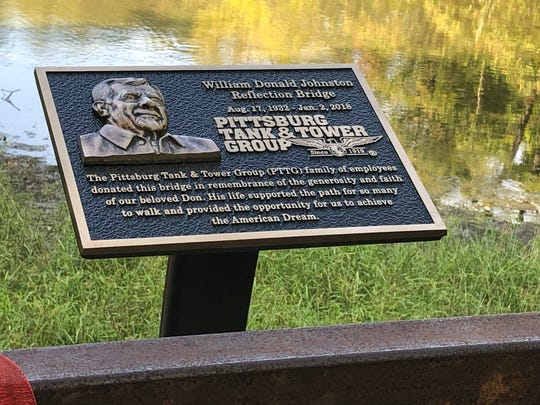 A plaque at the bridge in Audubon Park built by Pittsburg Tank & Tower employees honors former owner Don Johnston.