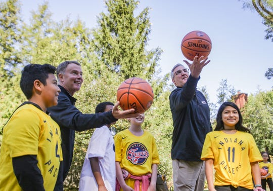 Mayor Joe Hogsett, left, and Governor Eric Holcomb toss basketballs in the air to tip off playing at the Governor's court, Tuesday, Oct. 8, 2019, at the Governors Mansion on 46th street, Indianapolis. Governor Eric Holcomb, Mayor Joe Hogsett and members of the NBA All-Star 2021 Host Committee board announced a million-dollar statewide legacy initiative giving $50,000 gifts to 21 youth organizations around Indiana.