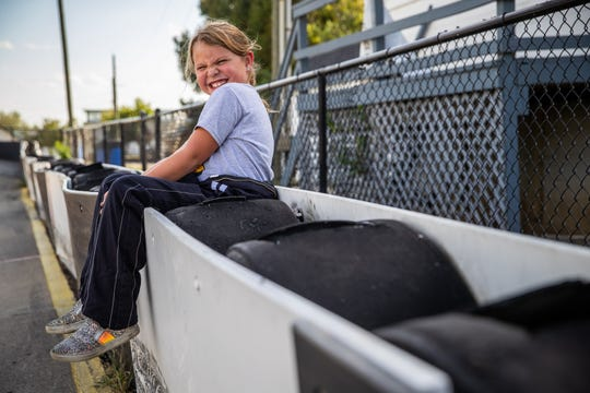 Kolette Dicero, 7, of Pittsboro, takes a break from practice and sits on the railing at Indy Mini Speedway at the Indiana State Fairgrounds on Oct. 1, 2019.