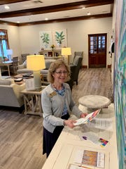 Joyce Burnett, bereavement counselor, places brochures about grief support group in the family room at Hospice Ministries in Ridgeland. Interior Spaces donated new furnishings for the room.