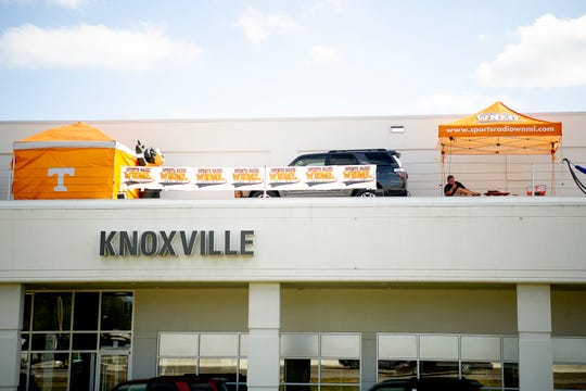 Local radio host Tyler Ivens of WNML camps atop Toyota Knoxville in West Knoxville, Tennessee on Tuesday, October 8, 2019. Ivens is camping on the roof of the car dealership until Tennessee wins their next game, which he is confident will happen Saturday when the Vols play Mississippi State.