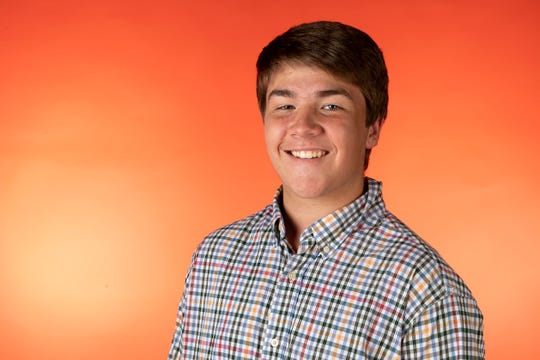 Luke Lampley, member of the Knox.biz 20 Under 20 class of 2019, in the Knox News photo studio in Knoxville, Tennessee on Wednesday, October 2, 2019.