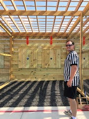 Ben Mooney, manager of the axe throwing at 865 Axe Throwing, runs through the rules during the grand opening on Oct. 5, 2019.