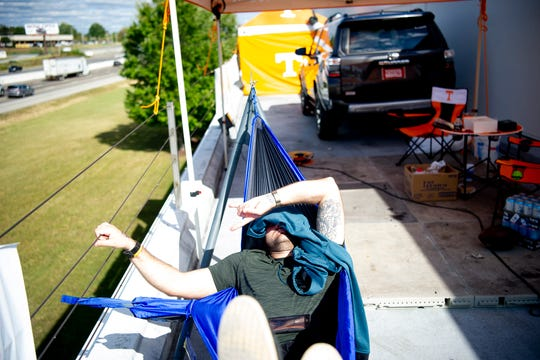Local radio host Erik Ainge of WNML rests in a hammock atop Toyota Knoxville in West Knoxville, Tennessee on Tuesday, October 8, 2019. Aigne was joining Tyler Ivens who is camping on the roof of the car dealership until Tennessee wins its next game, which he is confident will happen Saturday when the Vols play Mississippi State.