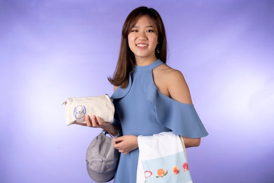 Yune Kim, member of the Knox.biz 20 Under 20 class of 2019, in the Knox News photo studio in Knoxville, Tennessee on Tuesday, October 1, 2019.