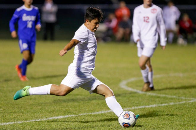 West Lafayette forward Austin Pacheco (9) kicks the ball towards the goal during the first half of an IHSAA boys soccer sectional match, Monday, Oct. 7, 2019 in West Lafayette. West Lafayette won, 4-3.