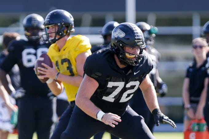 Purdue center Sam Garvin (72) blocks for Purdue quarterback Jack Plummer (13) after the snap during practice, Tuesday, Oct. 8, 2019 at Bimel Practice Complex in West Lafayette.