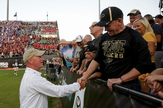 Purdue President Mitch Daniels greets spectators during the first quarter of a football game against TCU on Saturday, Sept. 14, 2019, at Ross-Ade Stadium.
