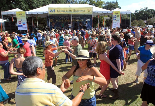 FILE PHOTO Festivalgoers dance at Scene Mon Heritage at the 2014 Festivals Acadiens et Créoles in Girard Park. Festivals Acadiens et Créoles, set for Oct. 12-15 in Girard Park, is looking for sponsors. FILE PHOTO Festival-goers dance at Scene Mon Heritage at the 2014 Festivals Acadiens et Créoles in Girard Park. Festival-goers dance at Scene Mon Heritage at the 2014 Festivals Acadiens et Creoles in Girard Park.Festival-goers dance at Scene Mon Heritage as Festivals Acadiens et CrAColes continues Saturday at Girard Park. Festival-goers dance at Scene Mon Heritage as Festivals Acadiens et CrAAoles continues Saturday, October 11, 2014, at Girard Park in Lafayette, La.