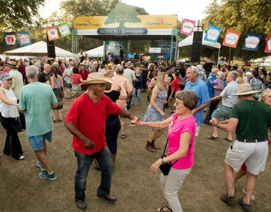 Festival goers enjoy dancing at Festivals Acadiens et Creoles