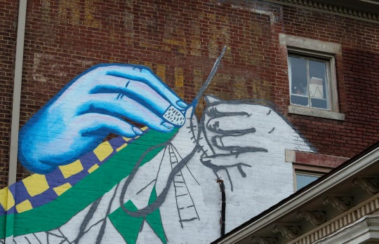 A mural in progress by Liz Richter at 786 S. Shelby St.