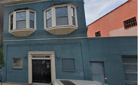 Three buildings on Baxter Avenue will be up for auction in November.