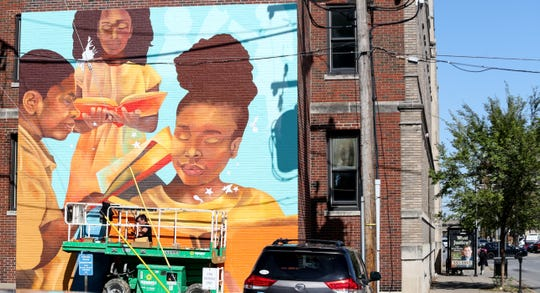 Annie Hamel created this mural on the back of 334 E. Broadway.