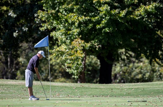 A man putts on a green at Shawnee Golf Course on Oct. 8, 2019.