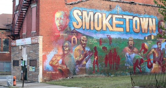 Victor Sweatt created this mural highlighting the historical giants of Smoketown on the side of Joe's Neighborhood Food Mart at 542 Lampton St.