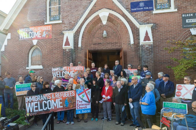 Speakers talk to media at St. William Catholic Church on West Oak Street as it announced it would now be a sanctuary church. Oct. 8, 2019