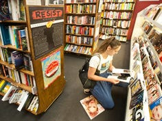 Emma Baird of St. Matthews looks through a magazine at  Carmichael's Bookstore on Frankfort Ave. in Crescent Hill.07 October 2019